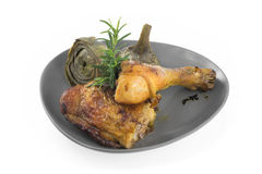 Roast chicken with artichokes Royalty Free Stock Images