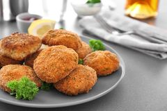 Plate with delicious salmon patties on table. Closeup Royalty Free Stock Images