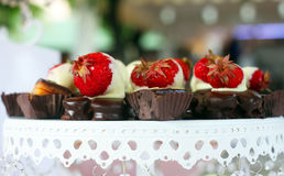 Plate with delicious strawberry cakes Stock Photo