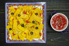A plate of delicious tortilla nachos with melted cheese sauce, c Stock Photo