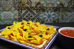 A plate of delicious tortilla nachos with melted cheese sauce, c Stock Image