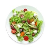 Plate with delicious vegetable salad on white background Royalty Free Stock Photos