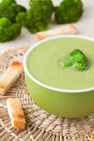 Plate of dieting healthy broccoli cream soup with Royalty Free Stock Photography