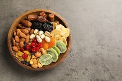 Plate with different dried fruits and nuts on table, top view. Space for text royalty free stock images