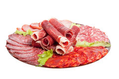Plate with different meat delicacies isolated on white background. Shallow depth of field.  royalty free stock image