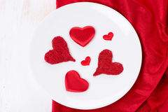Plate with different red hearts, concept, top view Royalty Free Stock Photo