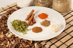 Plate with different spices on the table Stock Photos