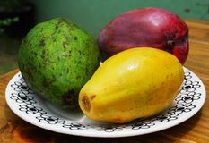 Plate with different tropical fruits Stock Photos