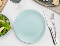 Plate on a dining table Royalty Free Stock Images