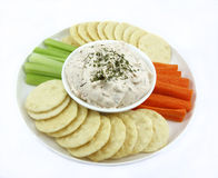 Plate Of Dip, Bisuits, Carrot and Celery Sticks. Royalty Free Stock Image