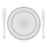 Plate and dishes against white Royalty Free Stock Image