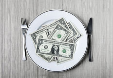 Plate of dollars Stock Photo