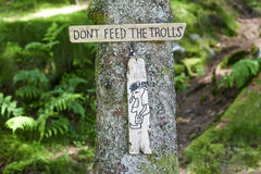 The plate: Don`t feed the trolls in forest in Norway. The plate: Don`t feed the trolls in forest in Norway Stock Image
