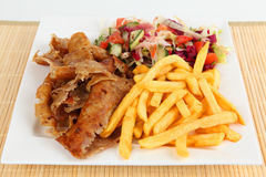 A plate with doner. Doner with salad and fries Royalty Free Stock Images