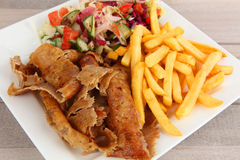 A plate with doner. Doner with salad and fries stock image
