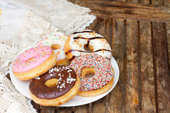 Plate of  donuts on table Stock Image