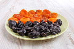 Plate of dried apricots and prunes. Stock Image