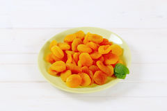 Plate of dried apricots Royalty Free Stock Photos