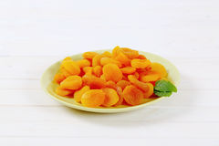 Plate of dried apricots Stock Photos
