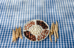 Plate dried beans mix pod on checked tablecloth Royalty Free Stock Images