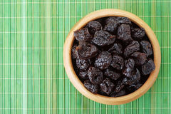 Plate with dried plums stock photography