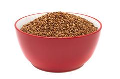 Plate with dry buckwheat Stock Images