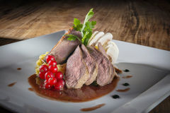 Plate with duck breast Stock Images
