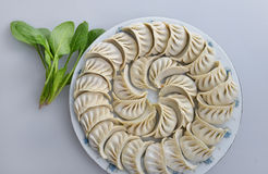 A plate of dumplings and spinach Royalty Free Stock Image