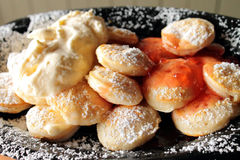 A plate of Dutch Poffertjes Royalty Free Stock Images