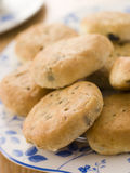 Plate of Eccles Cakes. On a blue floral patterned plate Royalty Free Stock Photos