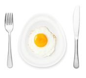Plate egg shape and fried egg Stock Photos