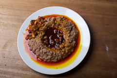 A plate of ewa agoyin. A Nigerian staple meal consisting of bread and baked beans with Agoyin sauce Royalty Free Stock Images