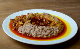 A plate of ewa agoyin. A Nigerian staple meal consisting of bread and baked beans with Agoyin sauce Stock Photo