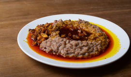 A plate of ewa agoyin. A Nigerian staple meal consisting of bread and baked beans with Agoyin sauce Stock Photos