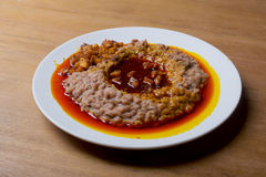 A plate of ewa agoyin. A Nigerian staple meal consisting of bread and baked beans with Agoyin sauce Stock Images
