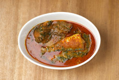 A plate of ewedu and gbegiri with fish and beef. stock photo