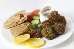 Plate of falafel with breat and salad Royalty Free Stock Images