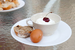 The plate with farmer cheese, piece of bread and boiled egg Stock Image