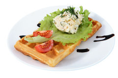 Plate with fast food, Belgian waffle, side dish, tomato, lettuce Stock Photo