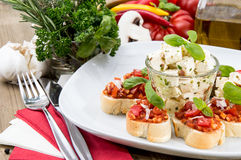Plate with Feta Cheese and Bruschetta Stock Photos