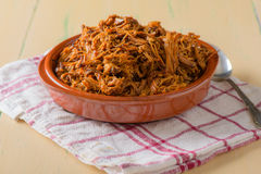 Plate filled with pulled pork on a round dish Royalty Free Stock Photos