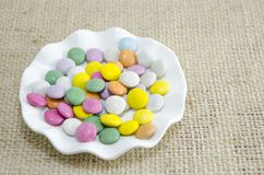Plate filled with small chocolates balls Royalty Free Stock Photos