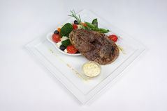 Plate of fine dining meal. Niceley decorated fine dining meal Stock Photo