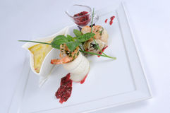 Plate of fine dining meal, halibut with vegetables. Roulade of halibut stuffed with vegetables from the wok, beet leaves and shrimps from the grill and served royalty free stock photography
