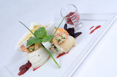 Plate of fine dining meal, halibut with vegetables. Roulade of halibut stuffed with vegetables from the wok, beet leaves and shrimps from the grill and served Stock Photo