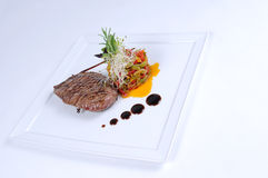 Plate of fine dining meal ostrich fillet salad Royalty Free Stock Photo