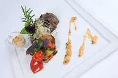 Plate of fine dining meal - tender ostrich fillet. Tender ostrich fillet, rosy-baked and served on paprika pepperonata with a creamy fig and balsamic sauce Royalty Free Stock Photography