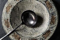 Plate with fish pattern handpainted and serving spoon Royalty Free Stock Image
