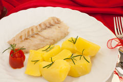 Plate With Fish And Potatoes stock images