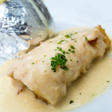 Plate of fish and potatoes Stock Photos